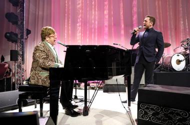 Sir Elton John and Taron Egerton perform onstage during the 27th annual Elton John AIDS Foundation Academy Awards