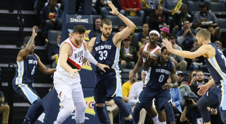 Portland Trailblazers center Just Kurkic (33) loses control of the ball as Memphis Grizzlies center Marc Gasol (33) and forward JaMychal Green (0) look on in the first quarter at FedExForum.