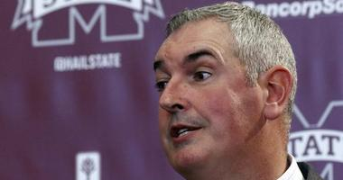 New Mississippi State football coach Joe Moorhead explains what he will be looking for in an assistant coach to reporters and team supporters at his official introduction by the university, Thursday, Nov. 30, 2017, in Starkville, Miss.