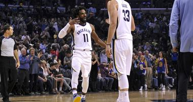 Memphis Grizzlies guard Mike Conley (11) and center Marc Gasol (33) celebrate during the second half against the Golden State Warriors at FedExForum.