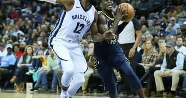 Indiana Pacers guard Darren Collison (2) drives against Memphis Grizzlies guard Tyreke Evans (12) in the first half at FedExForum.