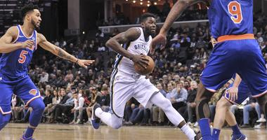 Memphis Grizzlies forward James Ennis III (8) goes to the basket against New York Knicks guard Courtney Lee (5) during the second half at FedExForum. Memphis Grizzlies defeated the New York Knicks 105-99.