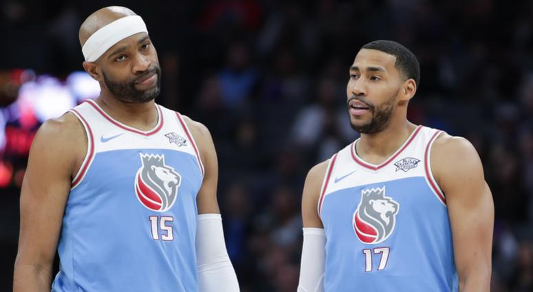 Sacramento Kings guard Vince Carter (15) and forward Garrett Temple (17)m react during the second half against the Detroit Pistons at Golden 1 Center.