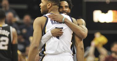 Memphis Grizzlies guard Mike Conley (11) and guard Andrew Harrison (5) celebrate during the second half against the San Antonio Spurs in game four of the first round of the 2017 NBA Playoffs at FedExForum. Memphis Grizzlies defeated the San Antonio Spurs