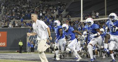 Memphis Tigers head coach Mike Norvell runs onto the field before the game against the Tulsa Golden Hurricane at Liberty Bowl Memorial Stadium.