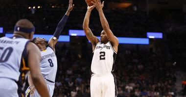 Kawhi Leonard and the Spurs held off Memphis 95-89 Tuesday in San Antonio in a possible playoff preview.