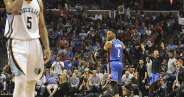 Oklahoma City Thunder guard Russell Westbrook (0) reacts away from Memphis Grizzlies guard Andrew Harrison (5) during the second half at FedExForum. Oklahoma City Thunder defeats the Memphis Grizzlies 103-100.
