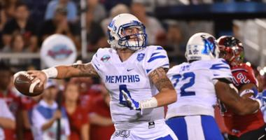 Memphis Tigers quarterback Riley Ferguson (4) attempts a pass against the Western Kentucky Hilltoppers during the first half at FAU Stadium.