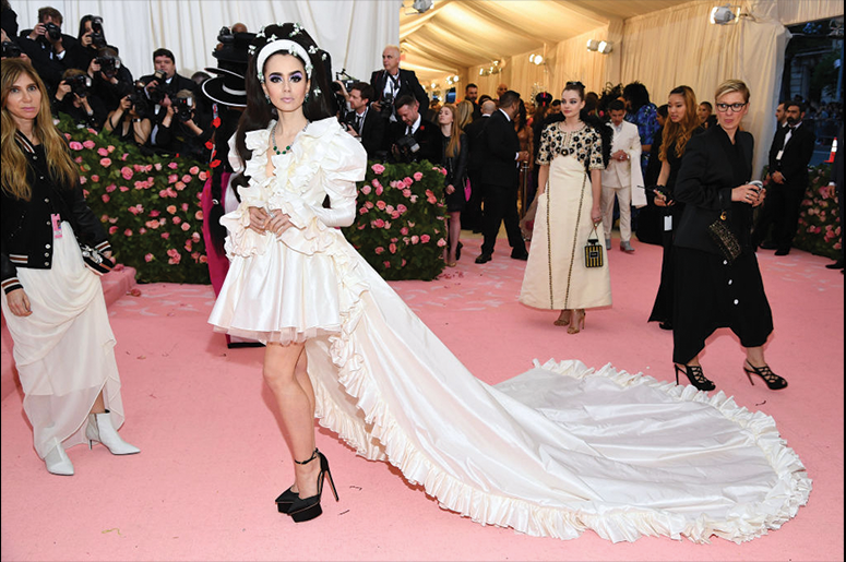 Lily Collins attends The 2019 Met Gala Celebrating Camp: Notes on Fashion at Metropolitan Museum of Art on May 06, 2019 in New York City. (Photo by Dimitrios Kambouris/Getty Images for The Met Museum/Vogue)
