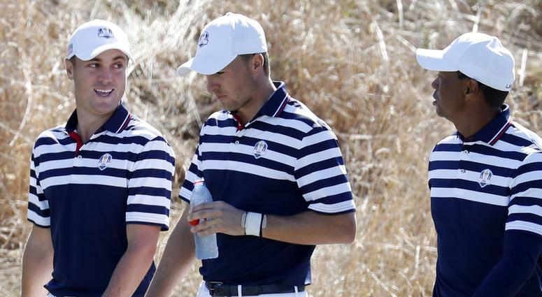 Tiger Woods, Jordan Spieth, and Justin Thomas