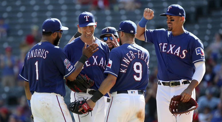 Arlington, TX, USA; Texas Rangers starting pitcher Mike Minor (23) celebrates with teammates during the ninth inning against the Boston Red Sox at Globe Life Park in Arlington.