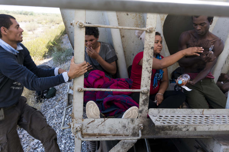 Oct 25, 2016; Sonora, Mexcio; A Honduran women traveling on a freight train, known by migrants as La Bestia, the beast, rests inside a train car south of Caborca, Sonora, about four hours from the border with Arizona.There has been a sharp rise in the num