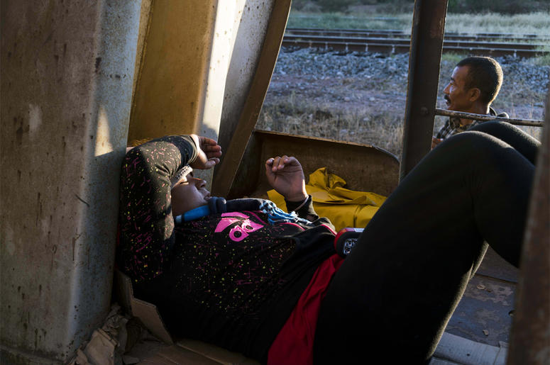 Oct 25, 2016; Sonora, Mexcio; A Honduran women traveling on a freight train, known by migrants as La Bestia, the beast, rests inside a train car south of Caborca, Sonora, about four hours from the border with Arizona. There has been a sharp rise in the nu