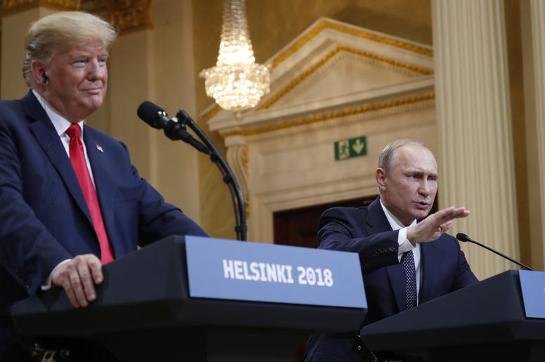 U.S. President Donald Trump, left, listens to Russian President Vladimir Putin during a press conference after their meeting at the Presidential Palace in Helsinki, Finland, Monday, July 16, 2018. (AP Photo/Pablo Martinez Monsivais)