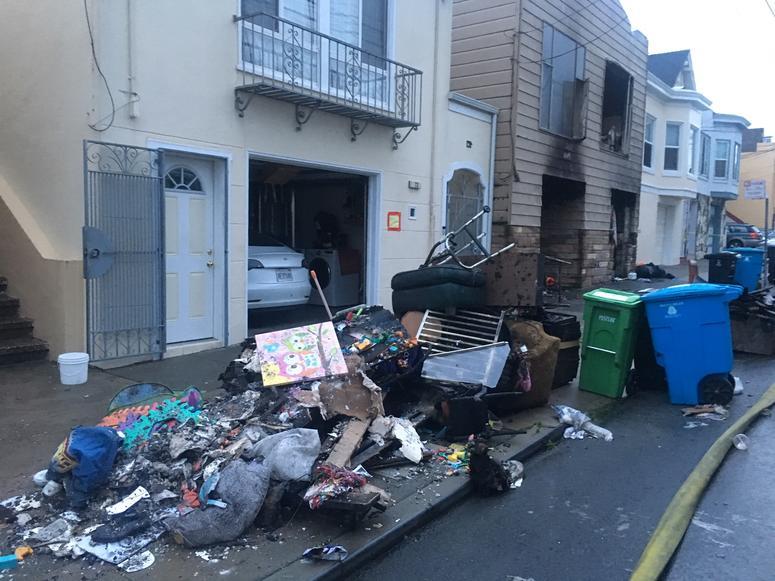 Burned items outside homes on Liebig Street, San Francisco