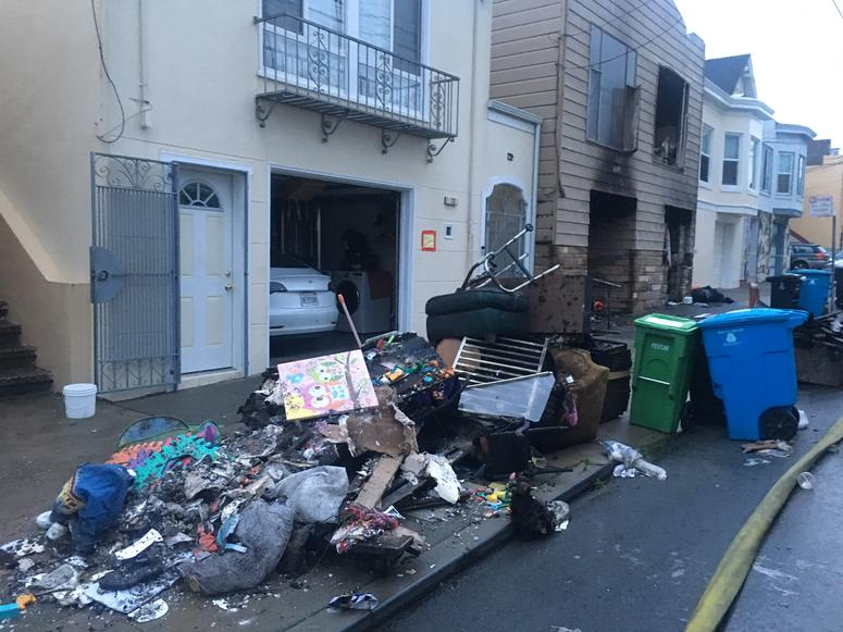 Burned items outside homes on Liebig Street, San Francisco