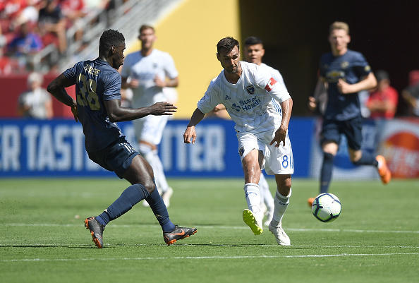 Chris Wondolowski #8 of the San Jose Earthquakes dribbles the ball up the field while defended by Axel Tuanzebe #38 of Manchester United during the second half of their exhibition soccer game at Levi's Stadium on July 22, 2018 in Santa Clara, California.