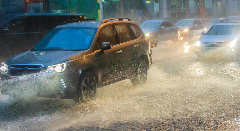 Driving car through the heavy hail and rain