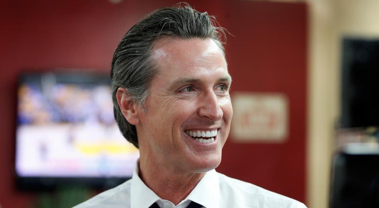 In this May 31, 2018 file photo Democratic Lt. Gov. Gavin Newsom smiles at a campaign stop at Stakely's Barber Salon in Los Angeles. Newson is expected to easily top the field in the race for govenor, but former Los Angeles Antonio Villaraigosa and state