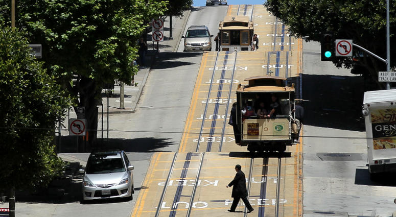 Cable cars travel along Powell Street on June 9, 2011 in San Francisco, California.