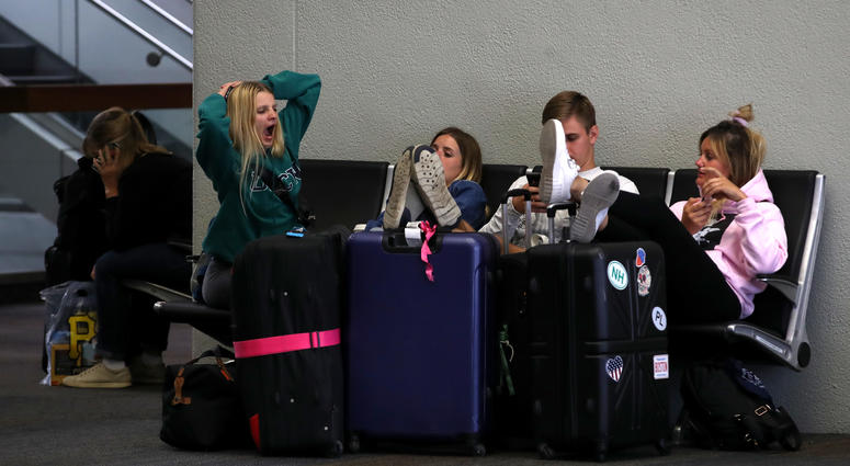 Travelers sit on a bench at San Francisco International Airport on September 09, 2019 in San Francisco, California.