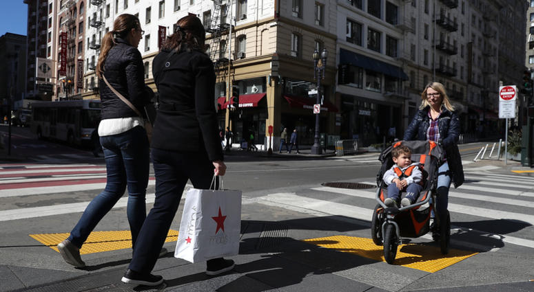 A shopper carries a shopping bag while walking in the Union Square district on February 27, 2018 in San Francisco, California.