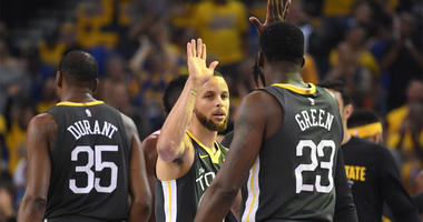 May 22, 2018; Oakland, CA, USA; Golden State Warriors guard Stephen Curry (facing camera) high-fives forward Draymond Green (23) during the first quarter in game four of the Western conference finals of the 2018 NBA Playoffs against the Houston Rockets at