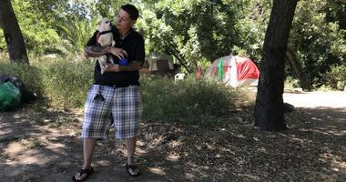 Angie Gonzalez holds her dog Wednesday in San Jose's Roosevelt Park.