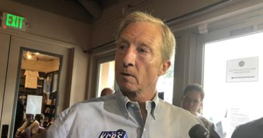 Tom Steyer speaks to reporters during a campaign stop at Manny's, a popular destination for candidates, in San Francisco on July 17, 2019.