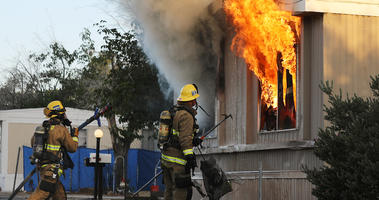 Firefighters work to put out an electrical house fire, the morning after a 7.1 magnitude earthquake struck in the area, on July 6, 2019 in Ridgecrest, California.