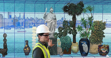 Artist Robert Minervini displays his work during a preview of the new Harvey Milk terminal at San Francisco International Airport.
