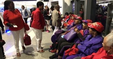 Members of the Ladies in Red group meet at Oakland International Airport on Aug. 8, 2019 to begin a civil rights tour in the South.