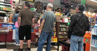 Line for lottery tickets at Eddie's Liquors