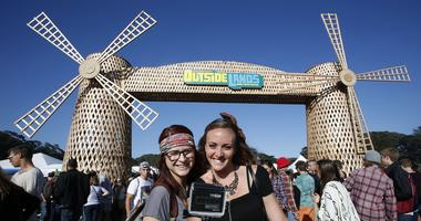 Claire Fabrocini, left, and Kim Horst, of Los Angeles, take a selfie with their GoPro camera during day one of the Outside Lands music festival at Golden Gate Park in San Francisco on August 8, 2014.