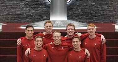 Stanford men's swim team graduates including Abrahm Devine, who says he was not invited back to train because he is openly gay
