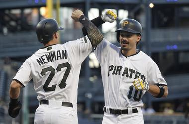 Pittsburgh Pirates shortstop Kevin Newman (27) greets center fielder Bryan Reynolds