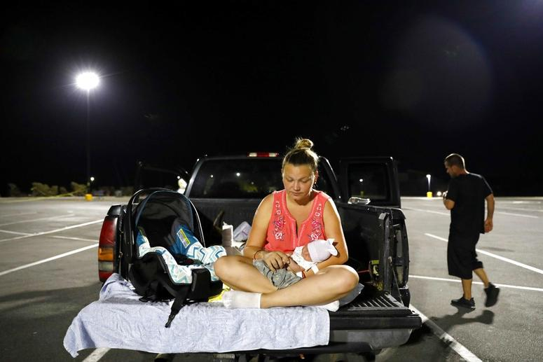 Lorrainda Smith, right, and husband Wilmer Capps prepare to spend the first night out of the hospital with their two-day-old son Luke in a parking lot in Florida.