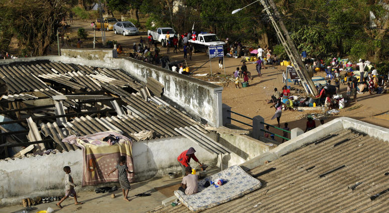 Displaced families set up their bedding on top of the roof in Buzi district, 200 kilometers (120 miles) outside Beira, Mozambique