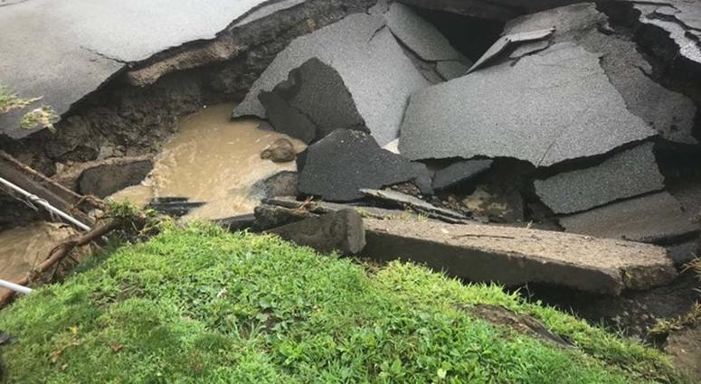 Heavy Rains Cause Sinkhole To Open Along McKnight Road