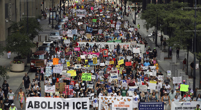Thousands of people, including immigrants and their supporters, rally against President Trump's immigration policies as they march from Daley Plaza to the Chicago field office of Immigration and Customs Enforcement, Saturday, July 13, 2019, in Chicago.