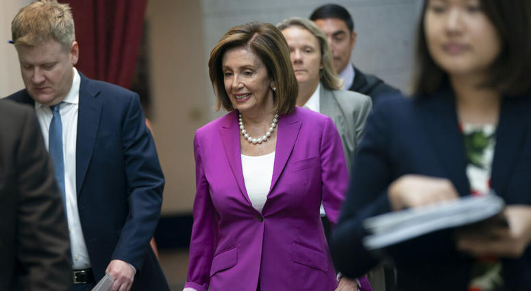 "House Speaker Nancy Pelosi, D-Calif., arrives for a closed-door session with her caucus before a vote on a resolution condemning what she called ""racist comments"" by President Donald Trump at the Capitol in Washin"
