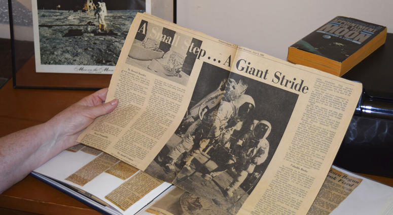 Cathy Goff shows her with newspaper clippings about the Apollo 11 moon landing mission at her home in King, N.C