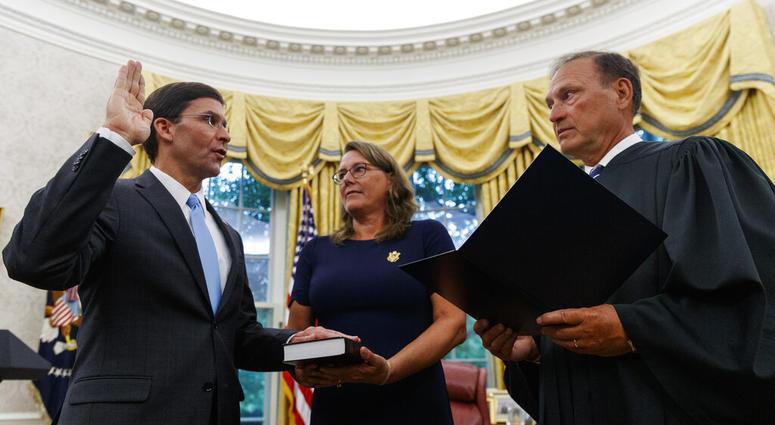 Mark Esper, left, is sworn in as the Secretary of Defense by Supreme Court Justice Samuel Alito, right