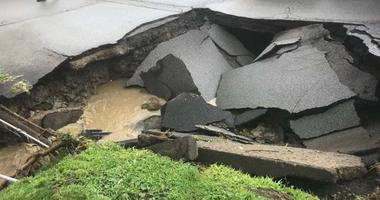 Heavy Rains Cause Sinkhole To Open Along McKnight Road