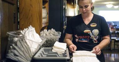 Shawna Green, waitress at Granny Shaffer's, prepares utensils for customers at the restaurant in Joplin, Mo
