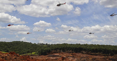 Helicopters hover over an iron ore mining complex to release thousands of flower petals paying homage to the 110 victims killed and 238 who are still missing after a mining dam collapsed there a week ago, in Brumadinho, Brazil