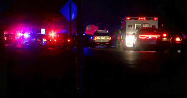 In this image made from a video provided by FOX19Now.com lights illuminate police vehicles as authorities respond to a standoff at an apartment complex in Ohio, about 20 miles east of Cincinnati on Sunday, Feb. 3, 2019.