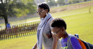 Corrie Davis, left, picks up her son Turner from Big Shanty Elementary School in Kennesaw, Ga.