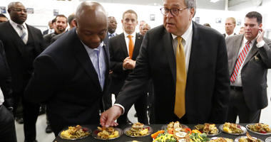 Attorney General William Barr, right, and Sen, Tim Scott, R-S.C., sample food prepared by an inmate culinary arts class during a tour of a federal prison Monday, July 8, 2019, in Edgefield, S.C.