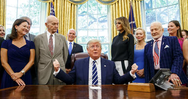 President Donald Trump, accompanied by Apollo 11 astronauts Michael Collins, second from left, and Buzz Aldrin, second from right, with Vice President Mike Pence and first lady Melania Trump, speaks during a photo opportunity commemorating the 50th annive